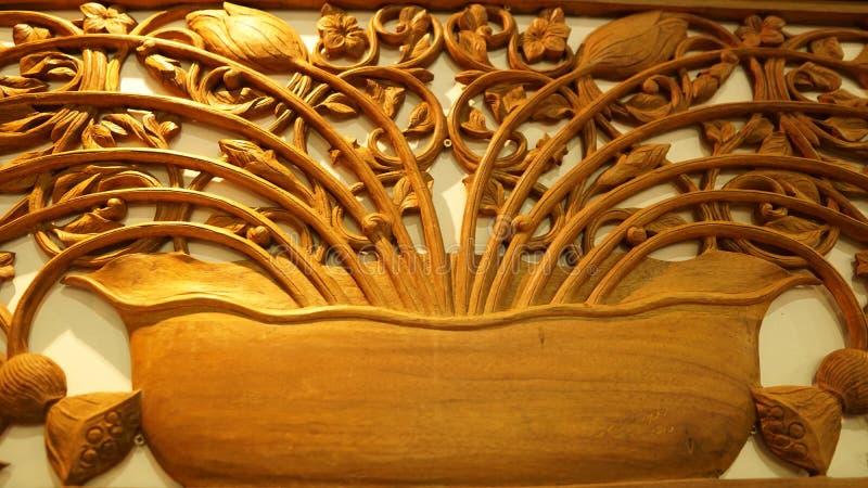 Het mooie kader van de de ambachtbloem van Maleisië houten stock foto