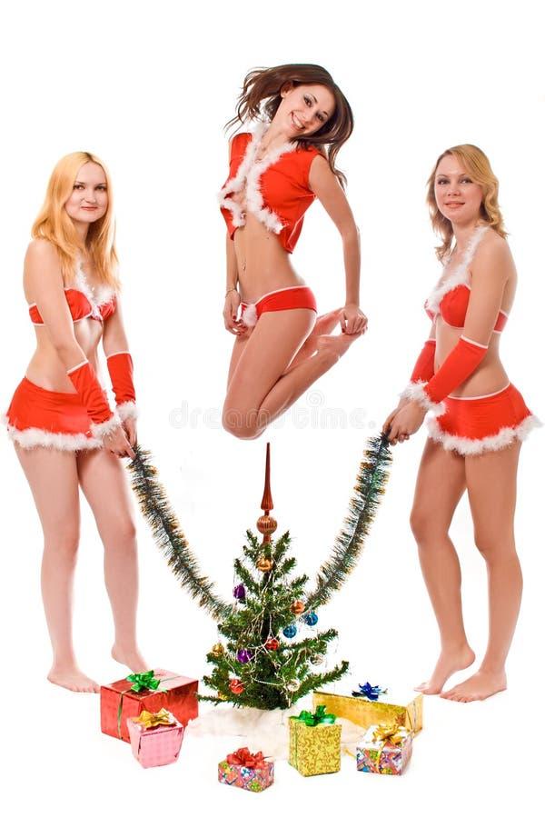 Het mooie kijken de meisjes van de santahelper stock afbeeldingen