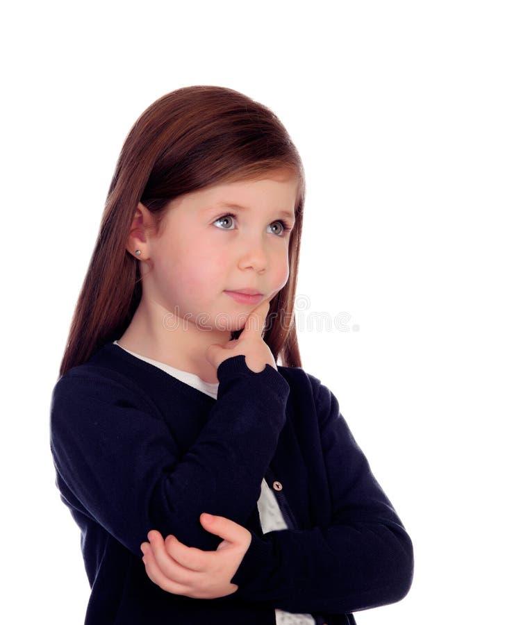 Het mooie meisje denken stock foto