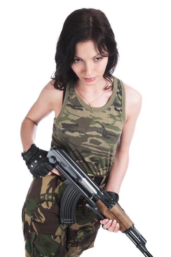Het mooie meisje met een automatisch geweer royalty-vrije stock foto's