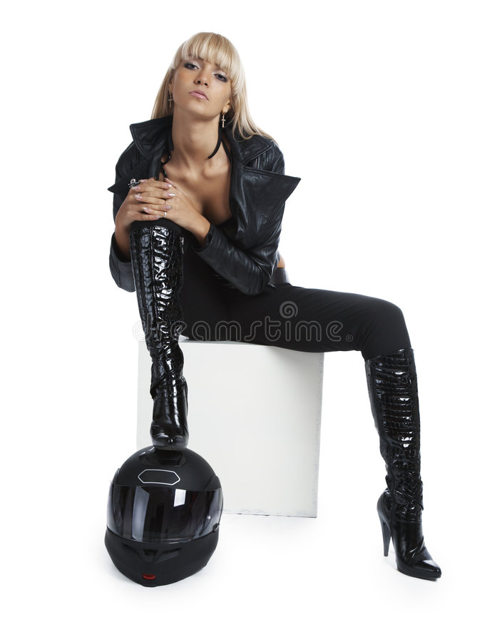 Het mooie meisje met een motorfietshelm stock afbeeldingen