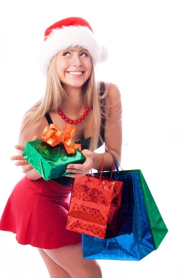 Het mooie meisje met Kerstmis stelt voor royalty-vrije stock foto