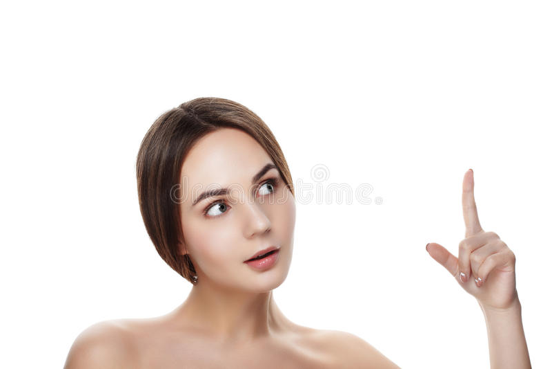 Het mooie meisje met natuurlijke make-up toont tot bovenkant Beautiful spa vrouw royalty-vrije stock afbeelding