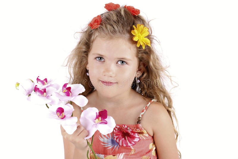 Het mooie meisje stellen met orchidee stock foto