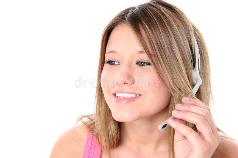 Het mooie Meisje van de Tiener met Hoofdtelefoon over Wit stock foto's