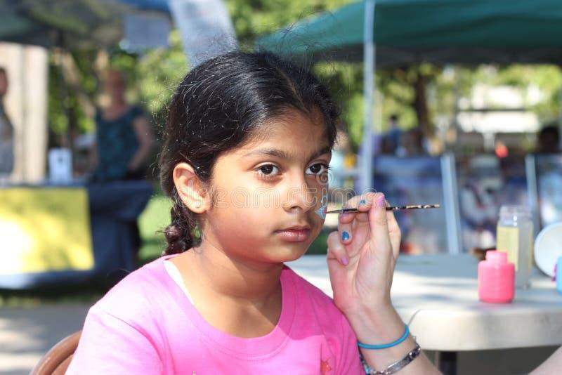 Het mooie meisjesgezicht schilderen royalty-vrije stock foto's