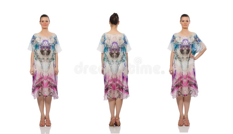 Het mooie model in lange elegante die kleding op wit wordt ge?soleerd royalty-vrije stock foto's