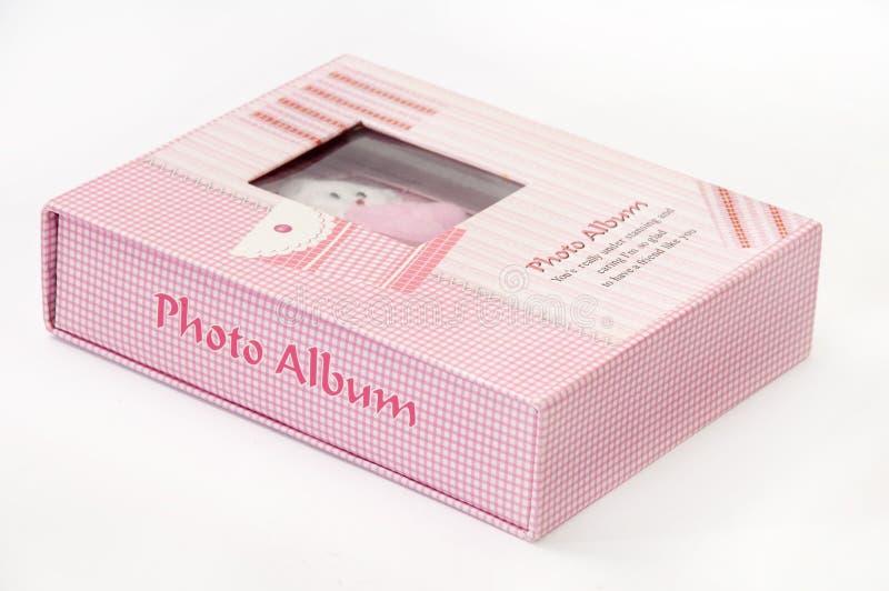 Het mooie roze album van de jonge geitjesfoto royalty-vrije stock fotografie