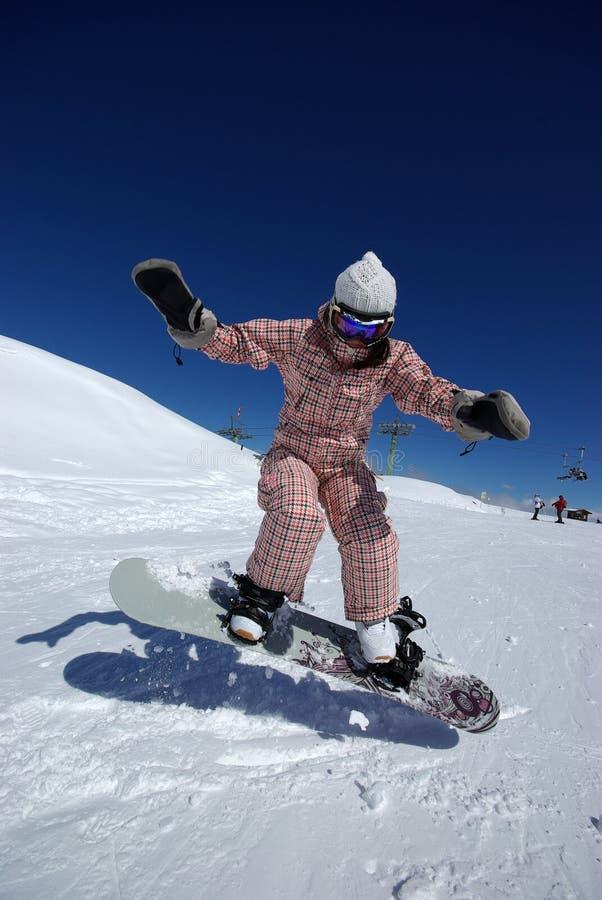 Het mooie snowboarder springen royalty-vrije stock fotografie