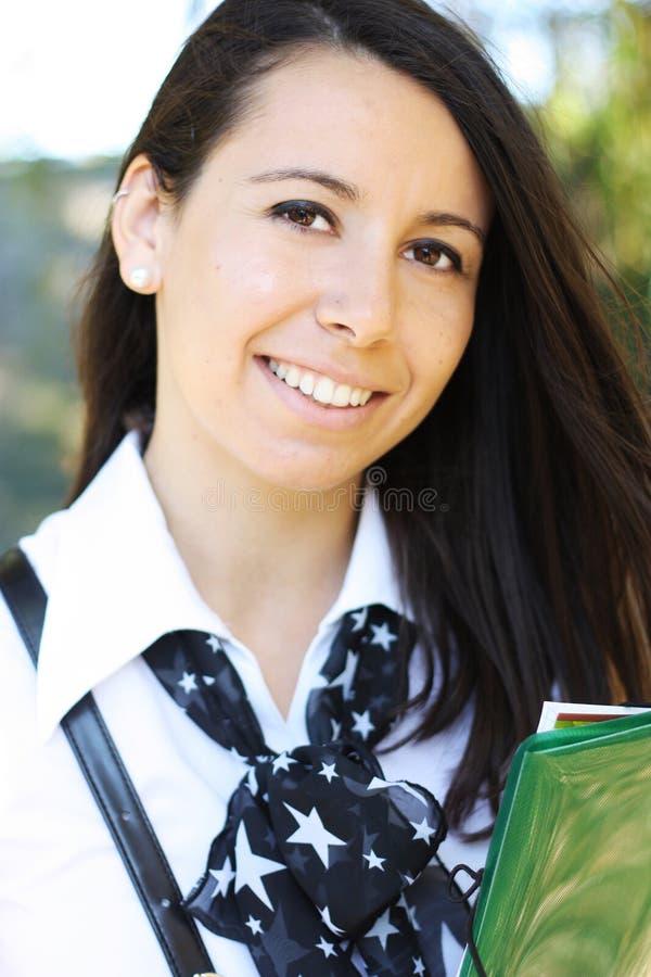 Het mooie student glimlachen stock afbeeldingen