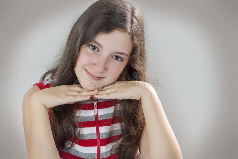 Het mooie tiener glimlachen royalty-vrije stock afbeelding