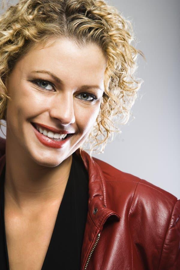 Het mooie vrouw glimlachen. royalty-vrije stock afbeeldingen