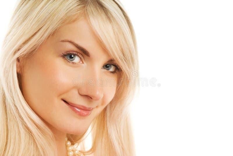 Het mooie vrouwengezicht glimlachen royalty-vrije stock afbeeldingen