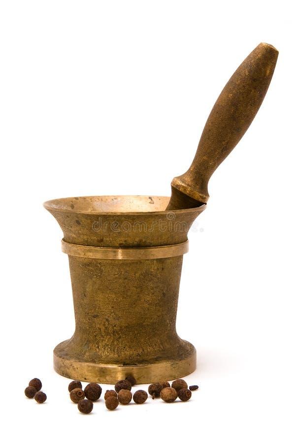 Het mortier van het brons met stamper stock foto