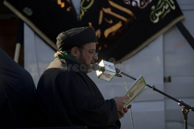 Het moslim Imam Bidden royalty-vrije stock afbeelding