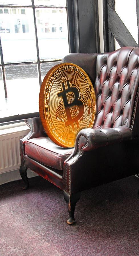 Het muntstuk die van Bitcoincryptocurrecy als voorzitter rusten stock fotografie