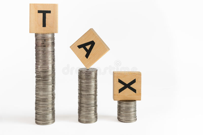 Het muntstuk stapelt belasting stock foto