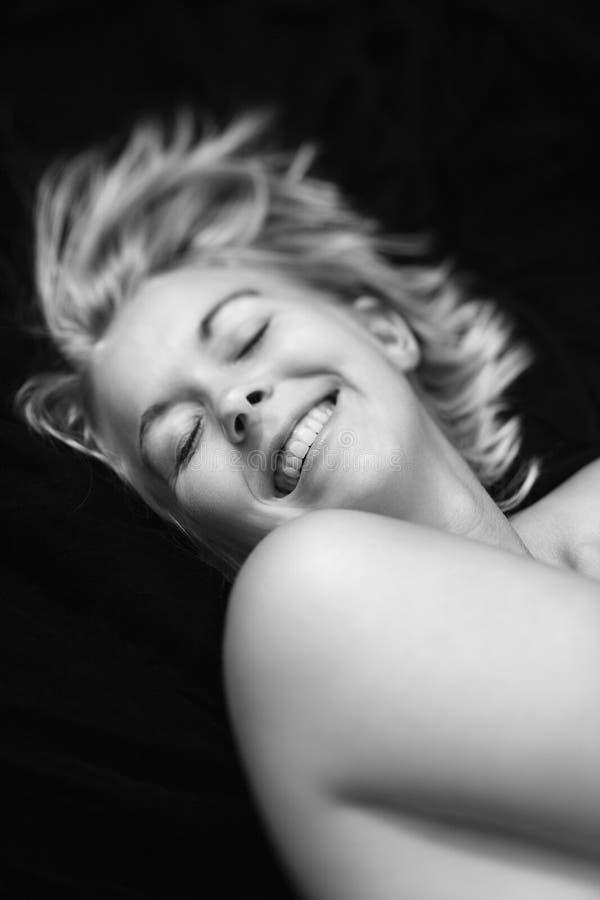 Het naakte vrouw glimlachen. stock foto