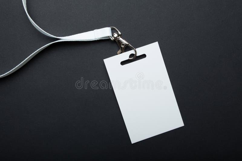 Het naamplaatje is leeg voor uw tekst, model Naamplaatje met wit lint en transparante plastic document houder Collectief ontwerp stock afbeeldingen