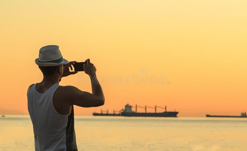 Het nemen van een foto stock fotografie
