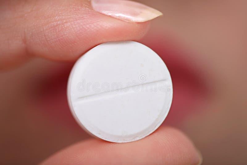 Het nemen van pillen royalty-vrije stock afbeelding
