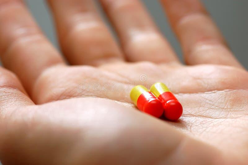 Het nemen van pillen stock afbeelding