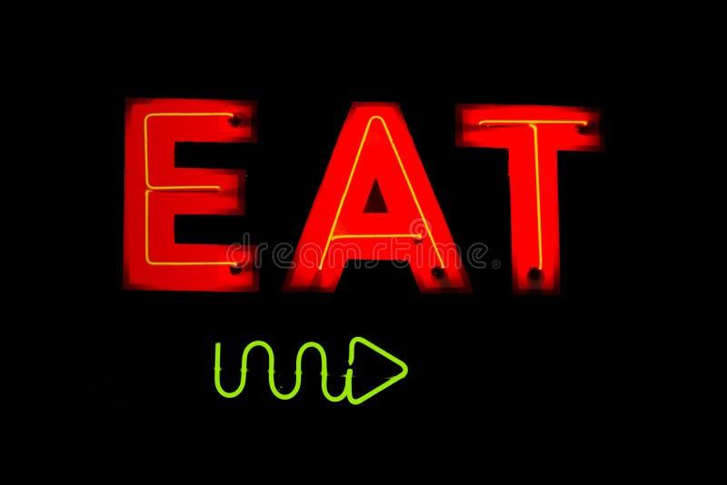 Het neon eet Restaurantteken stock fotografie