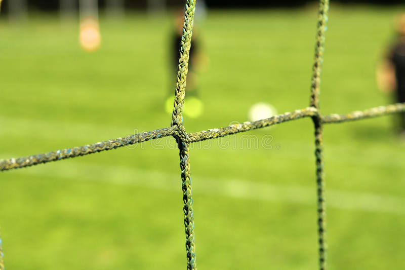 Het netto voetbaldoel stock afbeeldingen