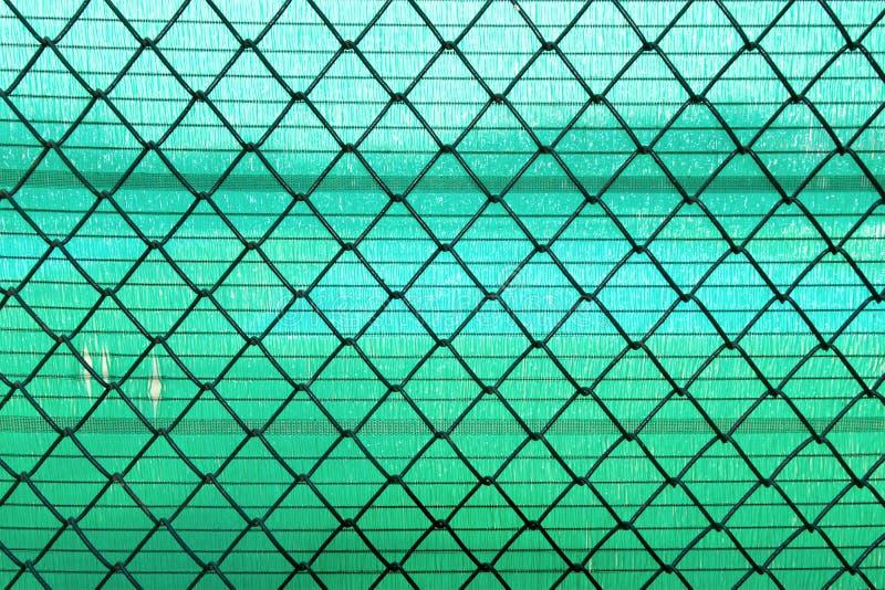 Het netwerk van de staaldraad op groene slan achtergrond royalty-vrije stock foto