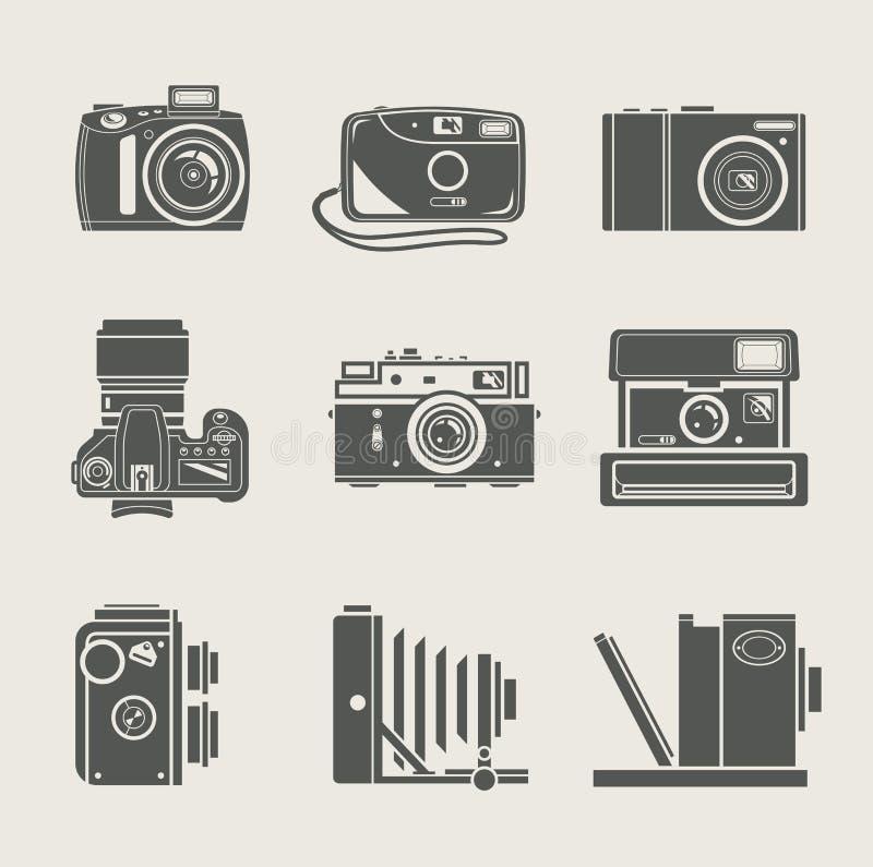 Het nieuwe en retro pictogram van de camera stock foto