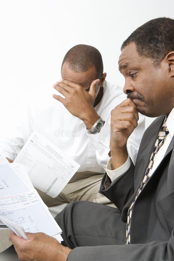 Het Nieuws van accountantsgiving client bad royalty-vrije stock foto