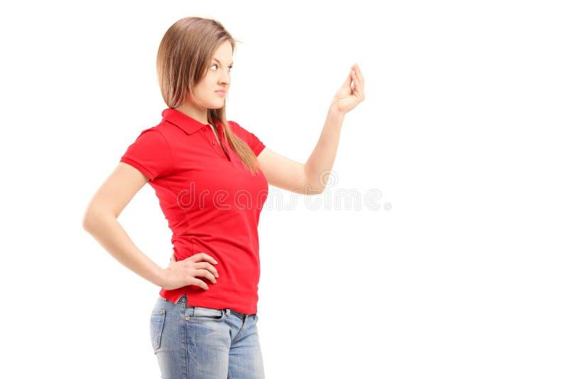 Het nieuwsgierige jonge vrouw gesturing met hand stock fotografie