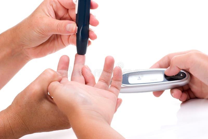 Het niveaubloedonderzoek van de glucose stock afbeeldingen