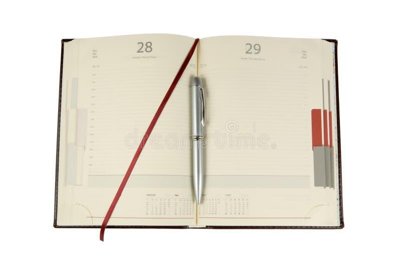 Het notitieboekje en het zilver ballpen royalty-vrije stock fotografie