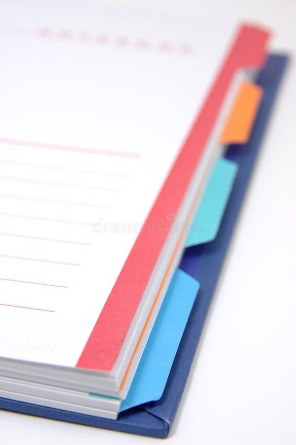 Het notitieboekje met classificeert pagina's stock afbeeldingen