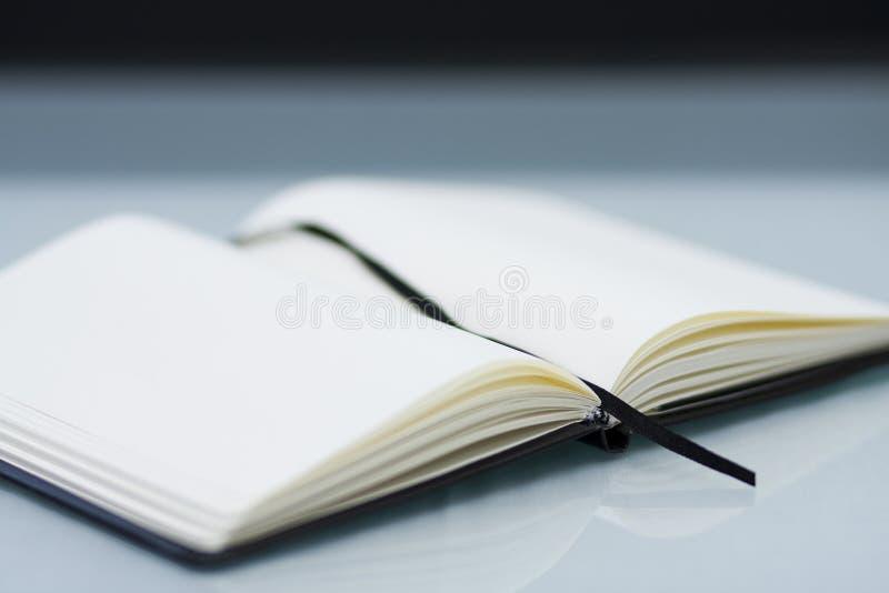 Het notitieboekje van de zak stock afbeeldingen