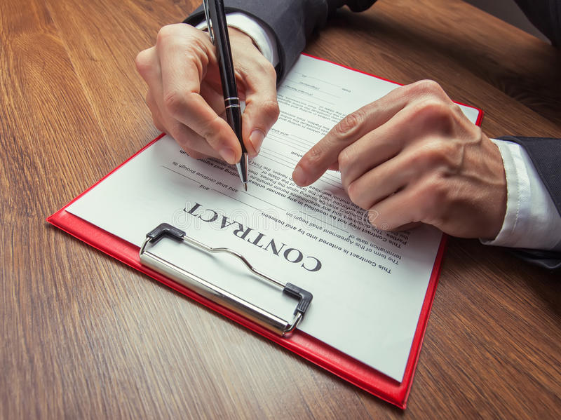 Het ondertekenen van Contract stock afbeelding