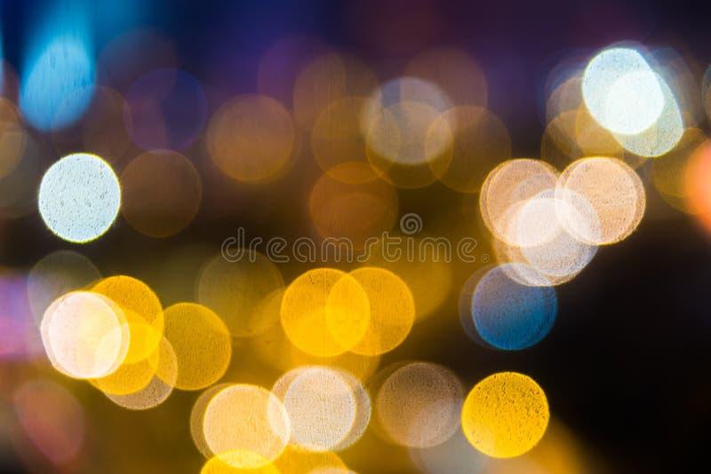 Het onduidelijke beeld defocused verlichte verlichting van straatmening stock foto's