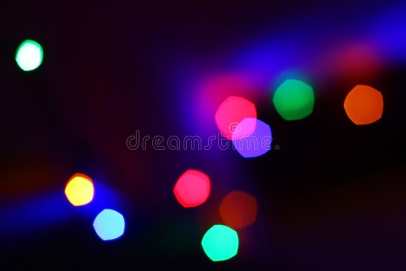 Het onduidelijke beeld van Chrismaslichten stock foto