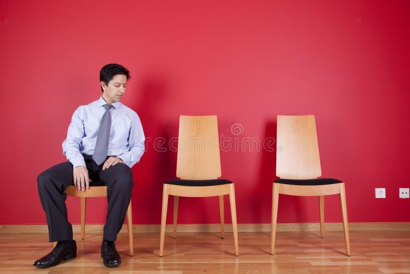 Het ontspannen van de zakenman stock afbeelding
