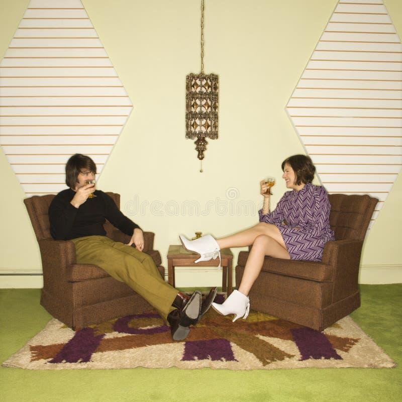 Het ontspannen van het paar als voorzitter. royalty-vrije stock afbeelding