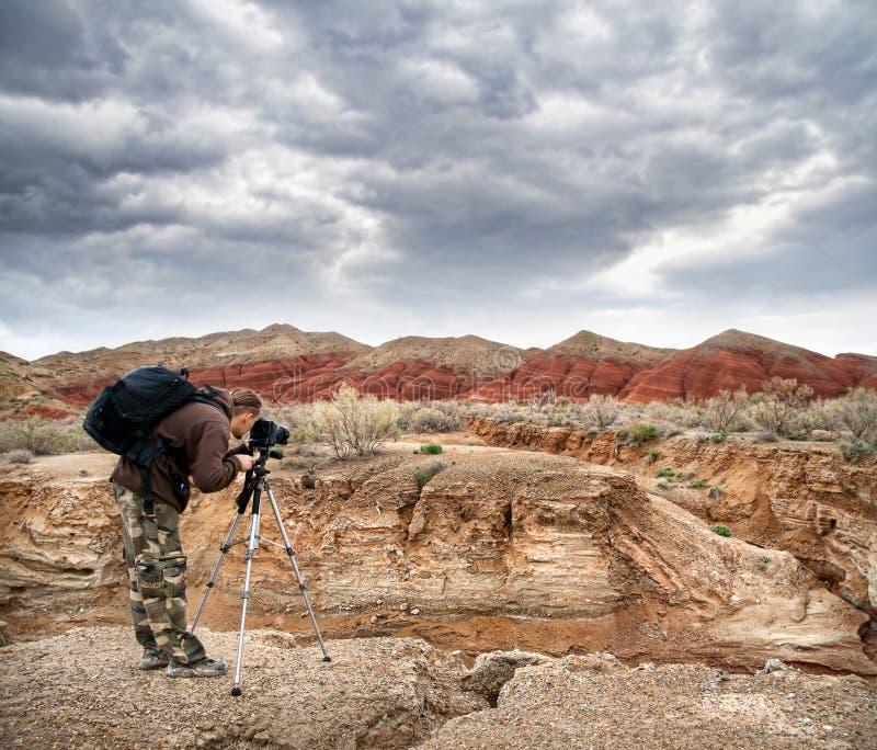 Het ontspruiten van de fotograaf aard stock foto