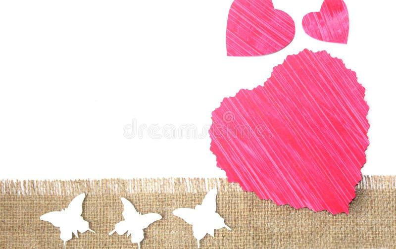 Het ontwerp sneed document harten en vlinders stock foto