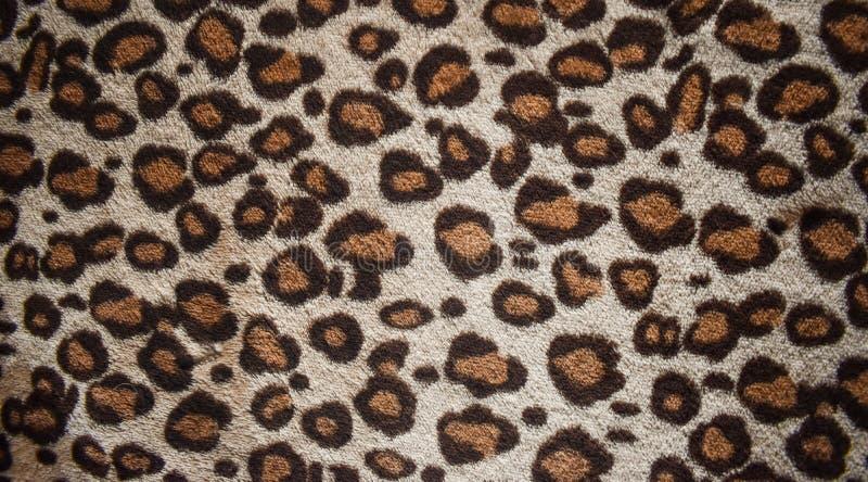 Het ontwerp van het luipaardpatroon, in natuurlijke bontachtergrond, het patroon naadloze echte harige textuur van het Luipaardbo stock afbeelding