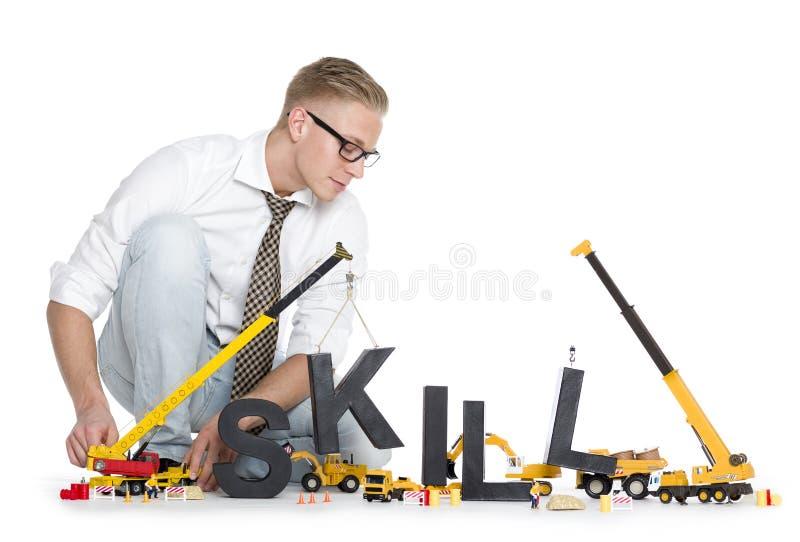 Het ontwikkelen van vaardigheden: De bouw van de zakenman vaardigheid-woord royalty-vrije stock foto's