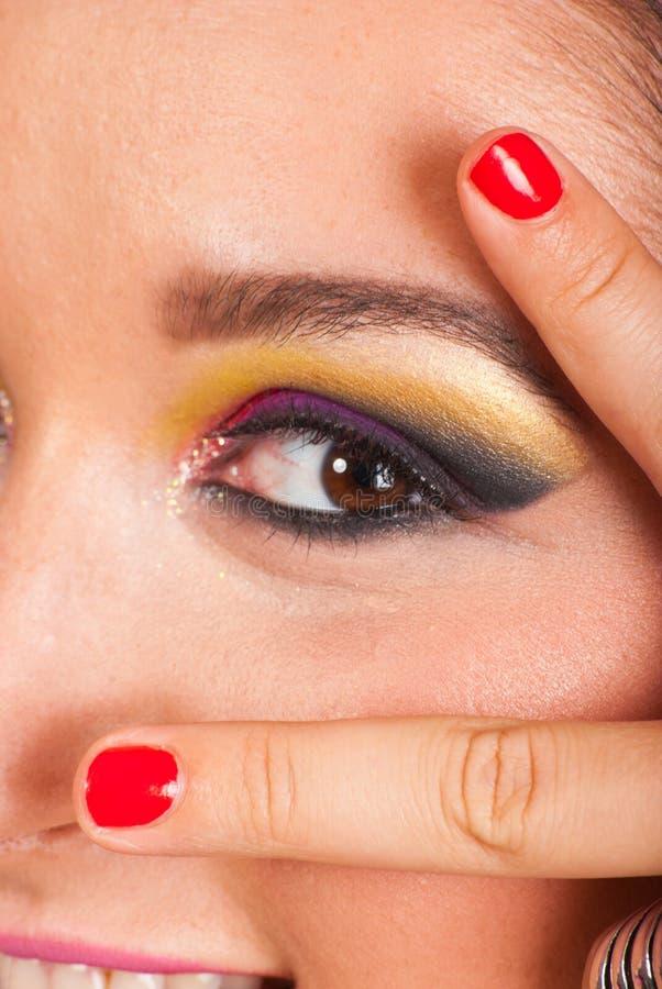 Het oog van de vrouw met aantrekkingskracht maakt omhoog stock foto's