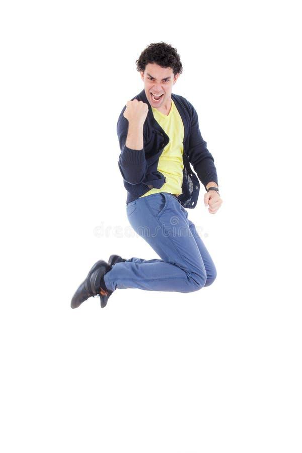 Het opgewekte succesvolle mens springen van vreugde met trotse uitdrukking royalty-vrije stock afbeeldingen