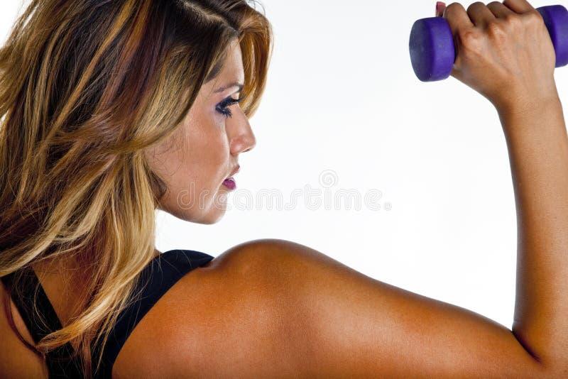 Het Opheffen van de vrouw Gewichten stock afbeeldingen