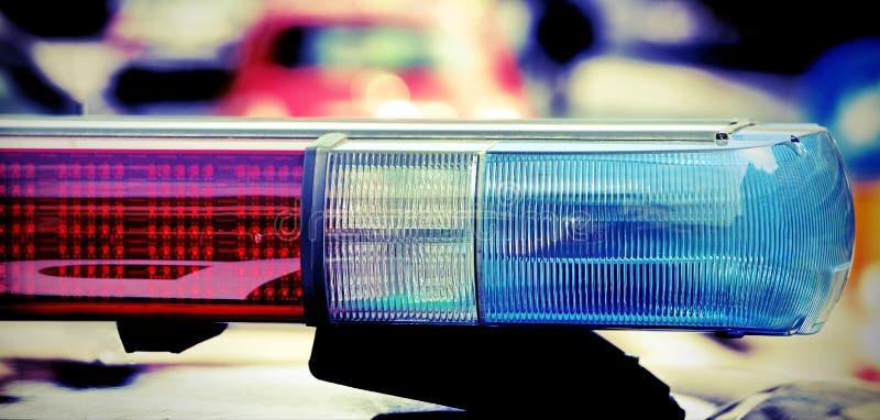 Het opvlammen en sirene van de politiewagen met uitstekend effect royalty-vrije stock foto