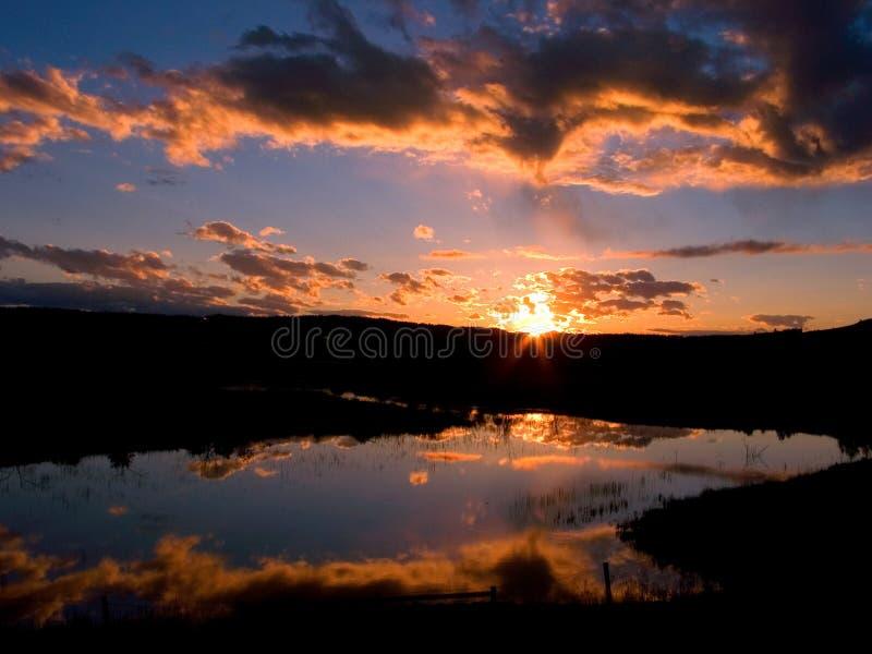 Het opvlammen Zonsondergang stock foto's